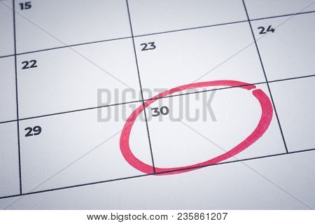 Closeup Blank Planner Calendar, Minimal Style Background. Focus On End Of Month With Red Circle Mark