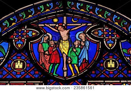 PARIS, FRANCE - JANUARY 09: Crucifixion, stained glass window from Saint Germain-l'Auxerrois church in Paris, France on January 09, 2018.