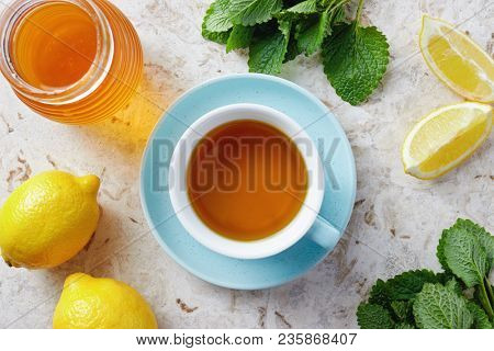 Lemon balm tea with honey. Cup of hot honey lemon balm tea. Lemon balm is a herb that belongs to the mint family and is known for its medicinal benefits.