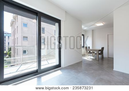 Modern living-room in new apartament with furniture. Nobody inside