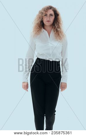 business woman striding confidently forward.