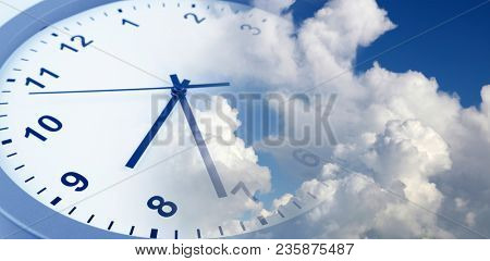 Clock face in blue sky. Time passing