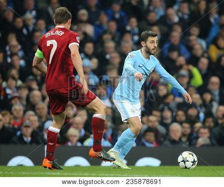 MANCHESTER, ENGLAND - APRIL 10: James Milner  and Bernardo Silva  during the Champions League quarter final match between Manchester City and Liverpool at the Etihad Stadium on April 10, 2018