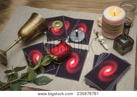 Tarot Cards On Fortune Desk Table, Empty Wine Goblet And Red Rose Flower. Future Reading Concept.
