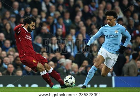 MANCHESTER, ENGLAND - APRIL 10: Mohamed Salah   and Leroy Sane  during the Champions League quarter final match between Manchester City and Liverpool at the Etihad Stadium on April 10, 2018
