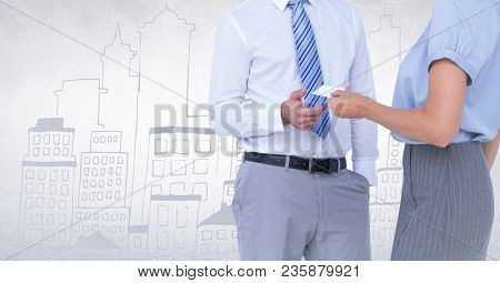 Business people mid sections swapping card against white wall with city doodle