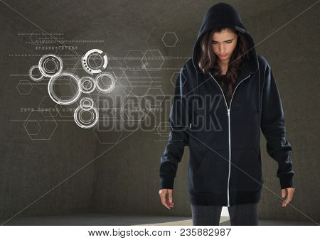 Woman hacker standing on in front of grey background with digital graphics