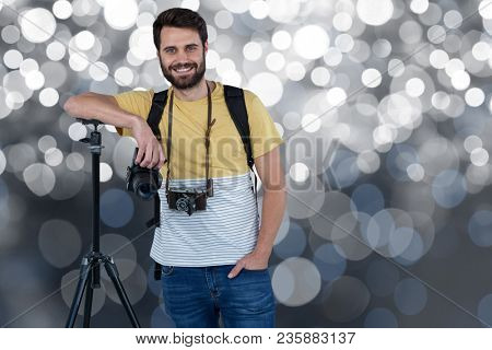 Smiling cameraman on a spotlight background