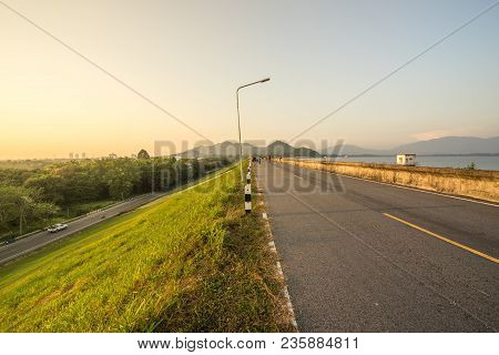Road On Dam Or Reservoir On Sunset Time - Can Use To Display Or Montage On Product