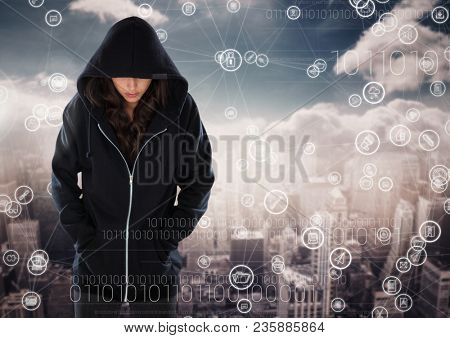 Woman hacker hooded standing on in front of digital background