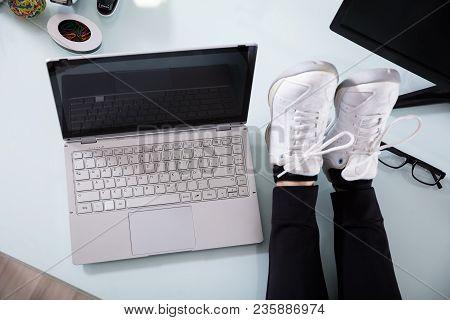 Businesswoman's Crossed Leg On Laptop