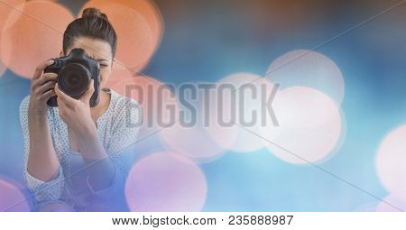 Photographer taking pictures against glowing background