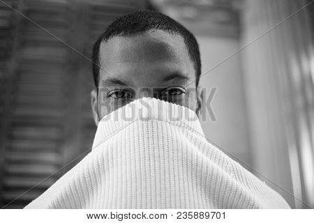Black And White Closeup Portrait Of Pensive Cute Young African-american Hipster In Informal White Je