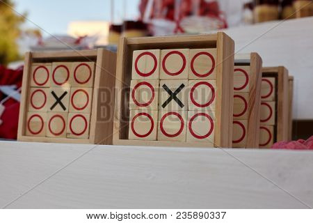 Tic-tac-toe Game On A White Wooden Background.