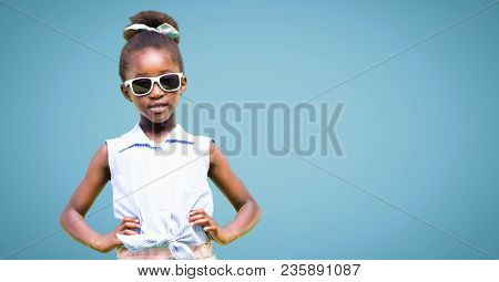Girl in sunglasses hands on hips against blue background