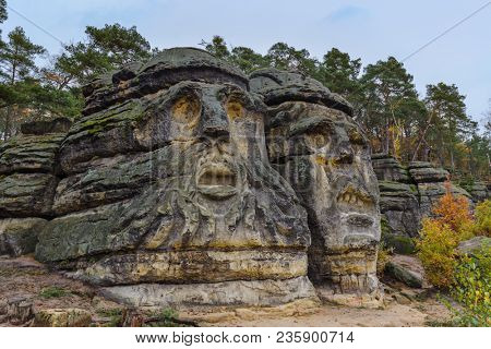 Sculptures Devil's heads in the village Zelizy - Czech republic - travel and architecture background