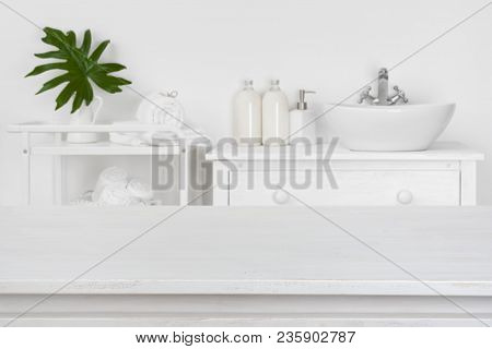 Wooden Table Top With Blurred Bathroom Interior For Product Display