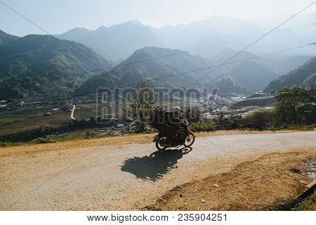 Sa Pa, Vietnam - 03 January, 2018: Person Riding Motorbike And Carrying Wood On Mountain Road, Sa Pa