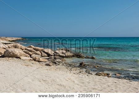 Rocky And Sandy Sea Coast In Cyprus