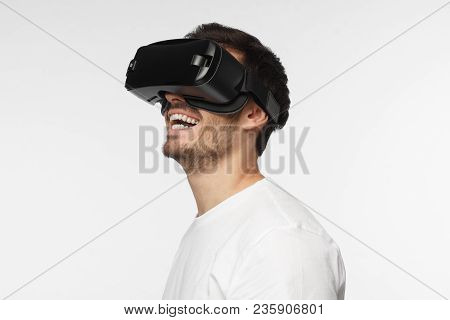 Portrait Of Young Man Wearing Vr Goggles, Experiencing Virtual Reality Using 3d Headset. Technology,