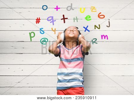 boy listening music with colour letters around