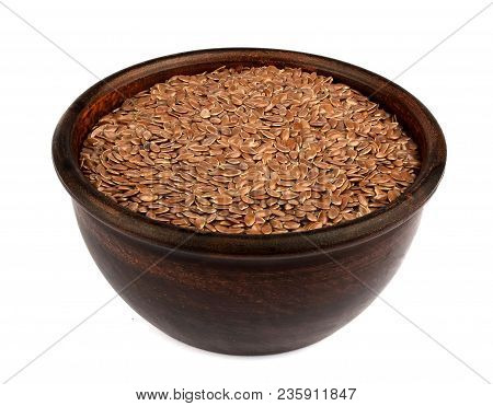 Flax Seeds In Ceramic Bowl Isolated On White Background. Also Known As Linseed, Flaxseed And Common