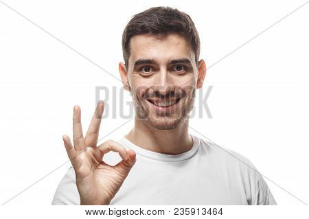 Young Man In Blank Tshirt Isolated On White Background Having Happy Look, Smiling, Gesturing, Showin