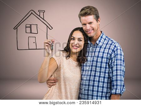 Couple Holding key with house drawing in front of vignette