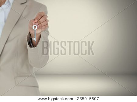 Hand Holding key in front of vignette