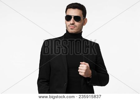 Tough Bodyguard Or Secret Agent Wearing Suit And Sunglasses, Isolated On Grey Background