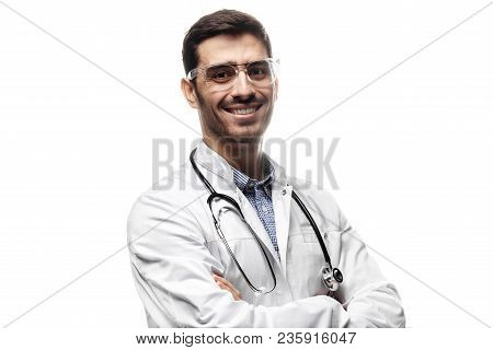 Horizontal Shot Of Handsome Man Physician Wearing White Uniform And Stethoscope Pictured Isolated On