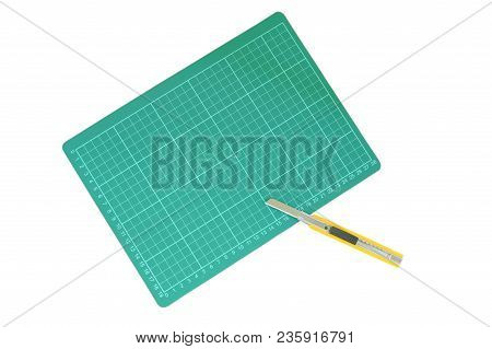 Cutter Opened Blade And Green Cutting Board On The White Background