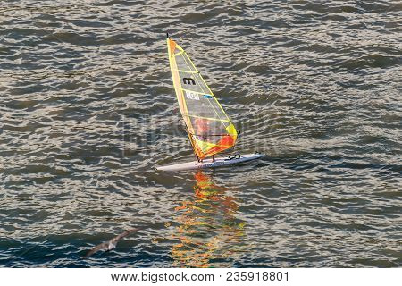 Funchal, Portugal - December 10, 2016: Windsurfer Catches Wind In The Bay Of Funchal, Madeira Island