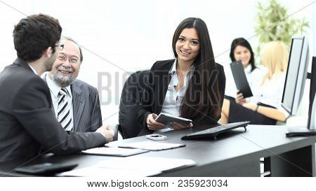 Business Colleagues At Their Desk In The Office .photo With Place For Text