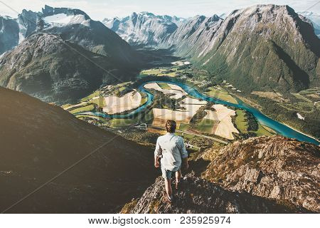 Man Traveler Alone Standing On Cliff Aerial Mountains Valley Landscape Traveling Adventure Lifestyle