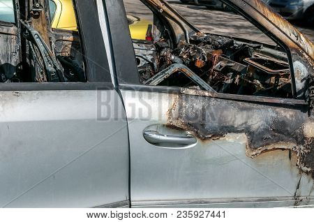 Damaged Car. Total Damage On New Expensive Burned Car In Fire On The Parking Lot, Selective Focus