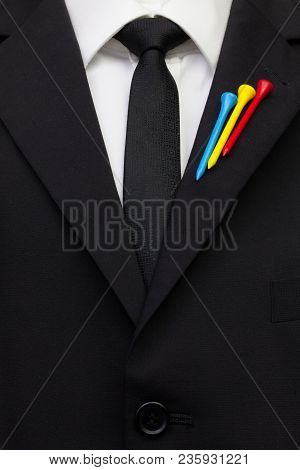 The Detail Of Wedding Suit With Golf Design.golf Tees In The Color Of The Moldavia Flag On The Flap
