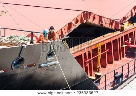 Sault Ste. Marie, Michigan/usa - June 26th, 2013: Two Shipmen Aboard A Freight Boat Passing Through