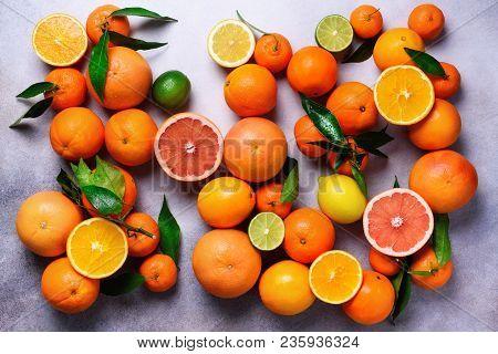 Citrus Fruits Background. Assorted Fresh Citrus Fruits With Leaves. Orange, Grapefruit, Lemon, Lime,
