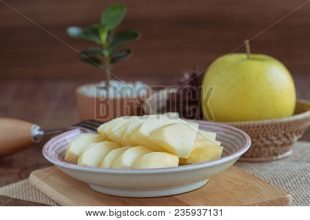Fresh Shinano Gold Apple Cut And Sliced To Piece Ready To Eat On Plate Put On Wood Table. Prepare De