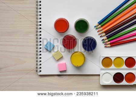 Developing Tools For Children's Creativity, Colored Pencils And Several Different Bottles Of Gouache