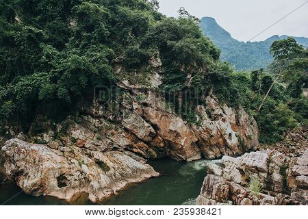 Green Vegetation On Rocks And Rapid River In Phong Nha Ke Bang National Park, Vietnam