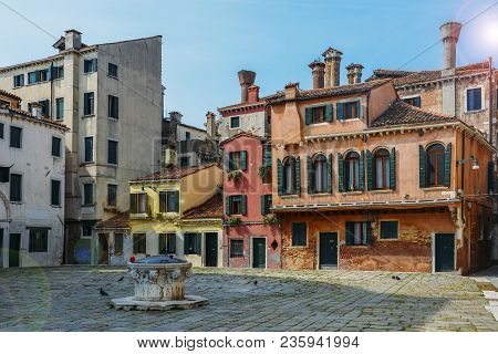 Colourful And Historic Houses At The Campo Della Maddalena In Venice, Italy, With A Variety Of Shape