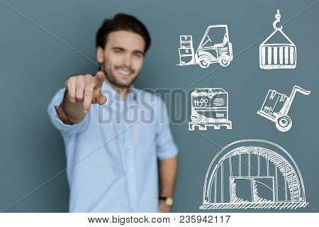 Working Hard. Enthusiastic Skilled Laborer Smiling And Looking Glad While Being At Work