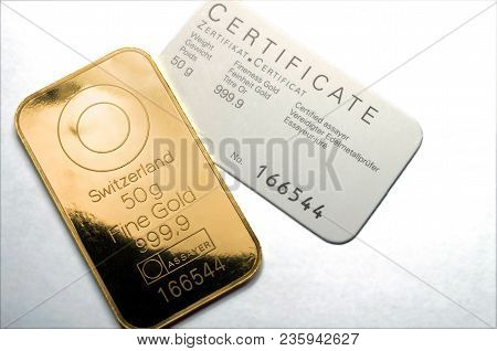 Minted Gold Bar Weighing 50 Grams With Certificate. Gold Ingot With Assay Certificate.