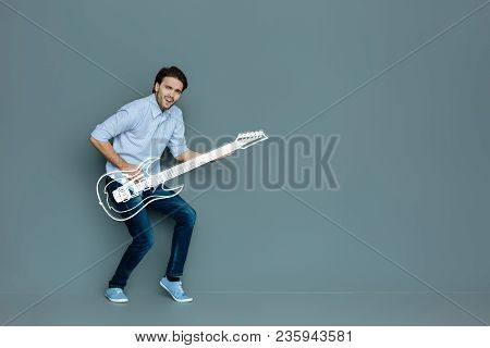 Guitar Player. Hardworking Enthusiastic Musician Playing The Guitar While Preparing For An Important