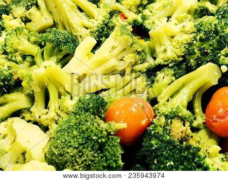Broccoli. Fresh Broccoli With Tomatoes And Spices. Salad With Broccoli