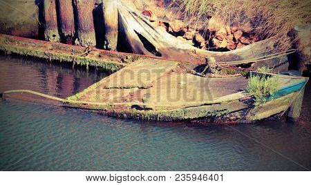 Wreck Of A Sunken Fishing Boat With Old Vintage Effect
