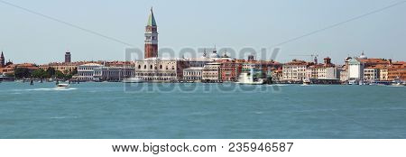 Island Of Venice In Italy With Ancient Palaces And Bell Towers With Long Exposure Time And The Wake