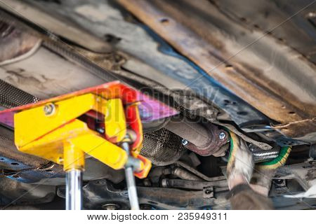 Repairing Of Corrugation Muffler Of Exhaust System In Car Workshop - Mechanic Fixes The Silencer Pip